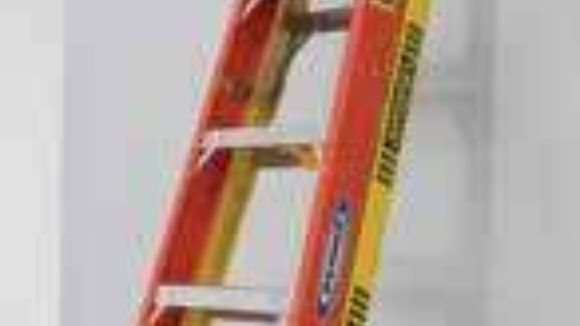 Ladder leans against walls