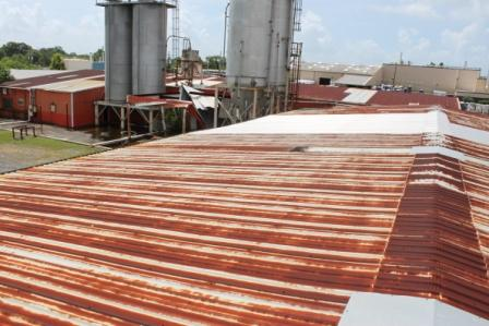 how to clean and maintain metal roofs