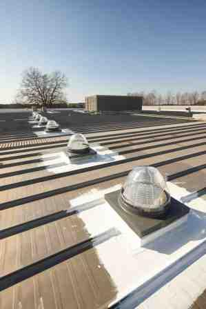 Velux_SunCurve_on_Metal_Roof_1.jpg