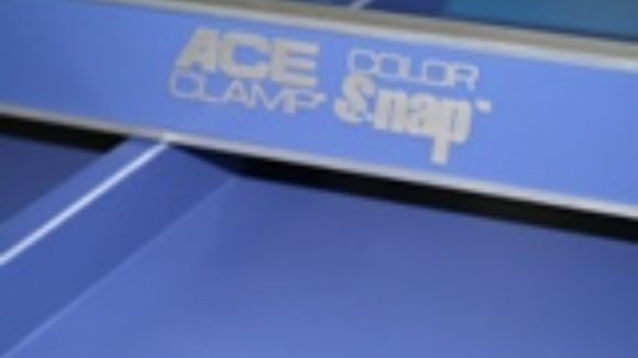 Snow retention bar snaps into retaining clips