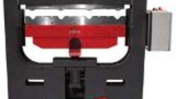 Metalforming machine raises ridge caps