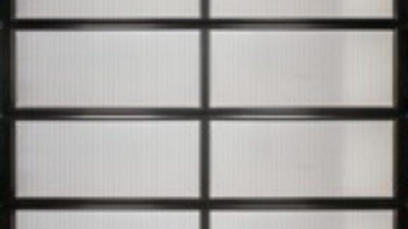 Aluminum frame supports polycarbonate glazing