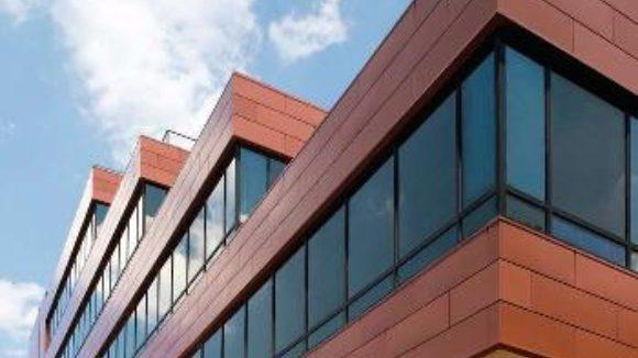 Metal upgrades terra cotta on university building