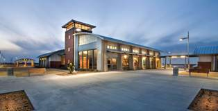 Secord & Lebow Architects LLP (SLA Architects) and a design team from the Texas Department of Transportation designed the Ward County Safety Rest Area in Pyote, Texas, to match the architectural form and detail of Pyote Air Force Base, a World War II bomber training base located nearby.