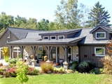 Allmet Roofing Products offers a variety of styles for its metal roof systems including Wood Shake.