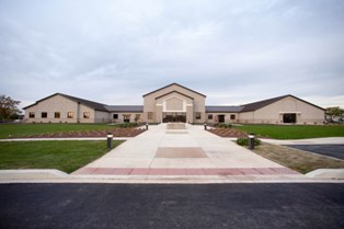 Bignell, Watkins, Hasser Architects designed the exterior elevations on Dover Air Force Base chapel to retain the image of a place of religious worship while avoiding specific architectural elements associated with individual faiths.