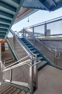 A four-story parking garage at Naval Hospital Camp Pendleton featuring Banker Wire metal fabric features a railing intended to provide a sense of serenity and security to those entering and leaving the hospital.