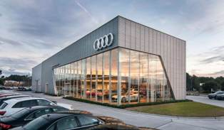 A triangular site and building footprint created a dynamic between the showroom, sales offices and service garage at Audi Cape Fear, Wilmington, N.C.