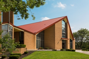 Florida Consulting LLC recommended Englert Inc.'s metal roof panels to re-roof St. Joseph the Worker Church, a contemporary brick building designed by Pittsburgh-based Kenneth Roos and built in 1962.