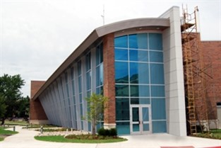 A modern, technological aesthetic was created for the J.D. and Mary West Science Laboratory at Southern Nazarene University with curves throughout the design.