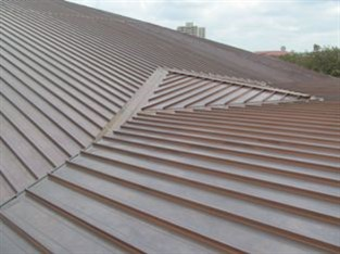 Byrne Metals Corp. installed more than 18,000 square feet of McElroy Metal's 20-ounce copper 238T standing seam roof panels to re-roof Miller Outdoor Theater in Hermann Park, built in 1968.