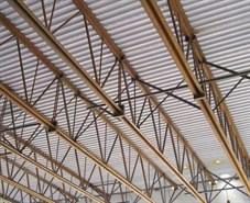 Metal construction news magazine feature steel joist for Wood floor joist bridging