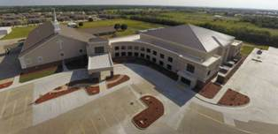 Mid-West Steel Building Co. supplied primary and secondary framing, 24-gauge BattenLok HS and Double-Lok roof panels for the 51,000-square-foot addition to Friendship Baptist Church, completed in 2013.