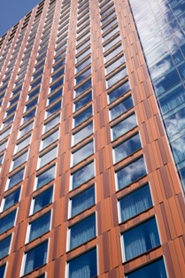 A combination of custom coatings supplied by Valspar Corp. replicated the appearance of weathered steel on the JW Marriott Convention Center Hotel.