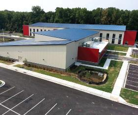Gary Cearfoss, president of Steel Building Specialists Inc., a Varco Pruden Buildings builder that constructed Monarch Global Academy, says metal was selected primarily for its cost.