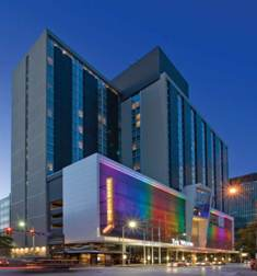 A fusion of rainbow-colored lights and custom Dolga-Trio architectural design mesh from W.S. Tyler USA Architectural Design Group was used to illuminate the Westin Cleveland Downtown's façade.